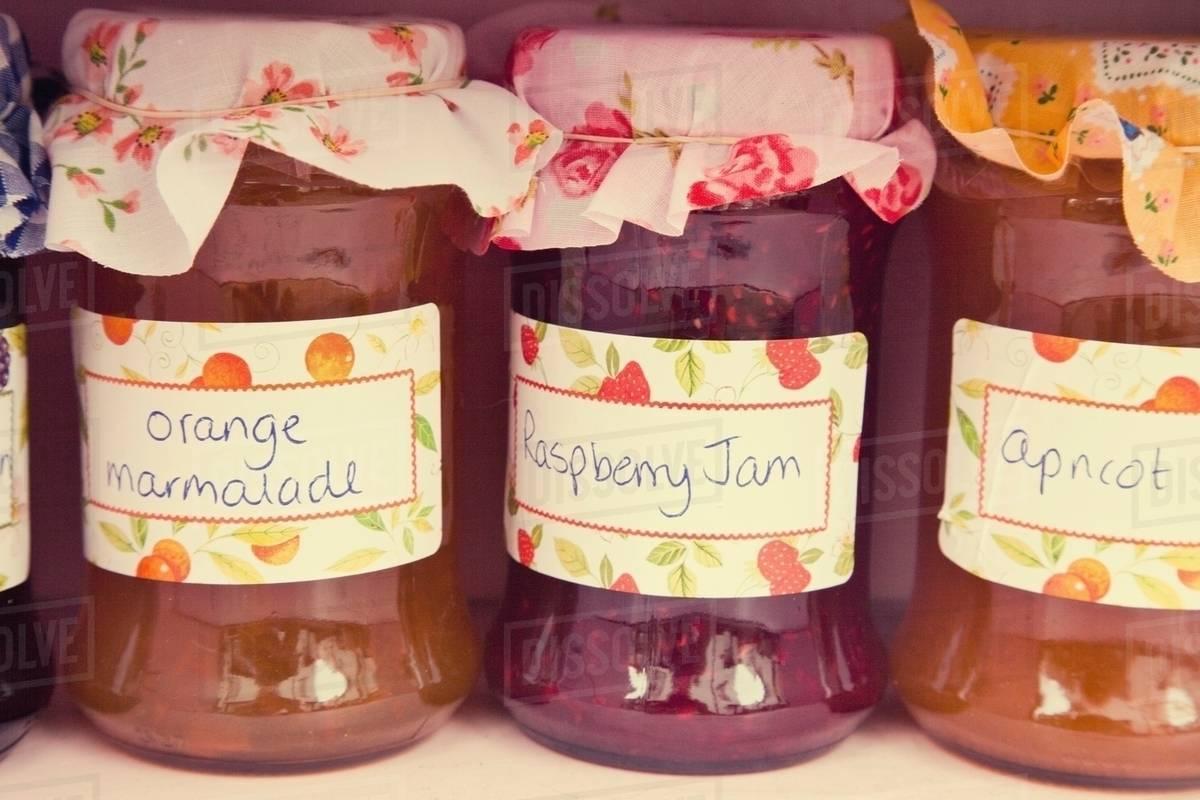 Close up of jars of homemade jam and marmalade