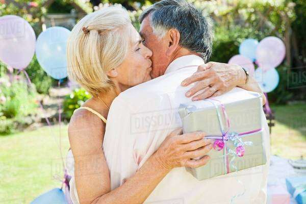 Mature woman kisses mature man. Royalty-free stock photo