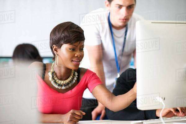 Students working on desktop computer in classroom Royalty-free stock photo