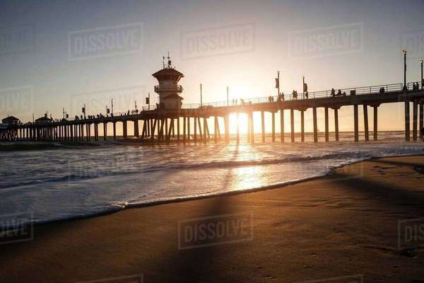 Silhouetted view of pier at sunset, Huntington Beach, California, USA Royalty-free stock photo