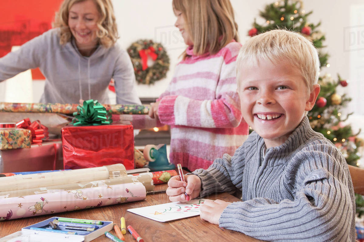 Mother and children wrapping christmas gifts - Stock Photo - Dissolve
