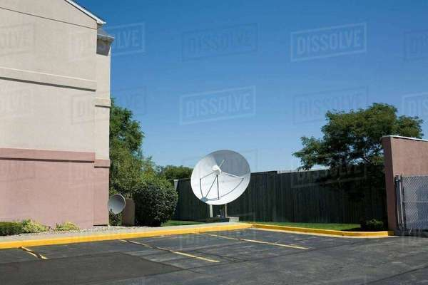 Satellite dish in parking lot Royalty-free stock photo