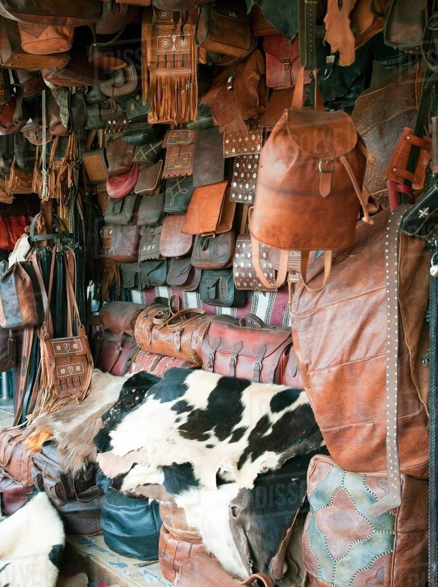Leather goods for sale near the Tannery in the medina of Fes, Morocco stock  photo