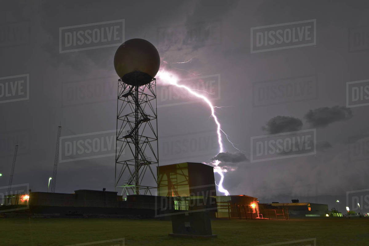 Lightning near a weather radar dome at the National Weather Service in  Norman, Oklahoma, USA stock photo