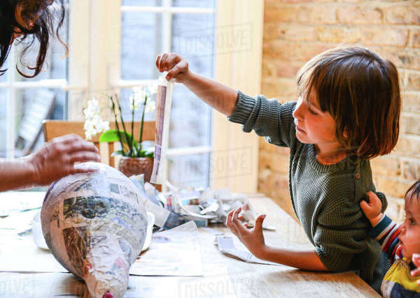 Child and mother playing with papier mache Royalty-free stock photo