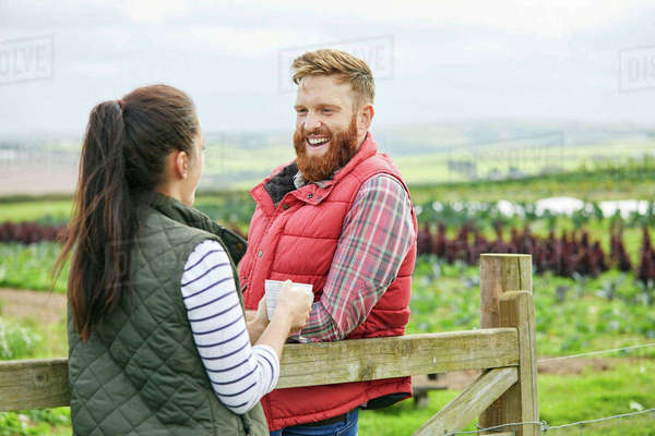Couple on farm enjoying a hot drink Royalty-free stock photo