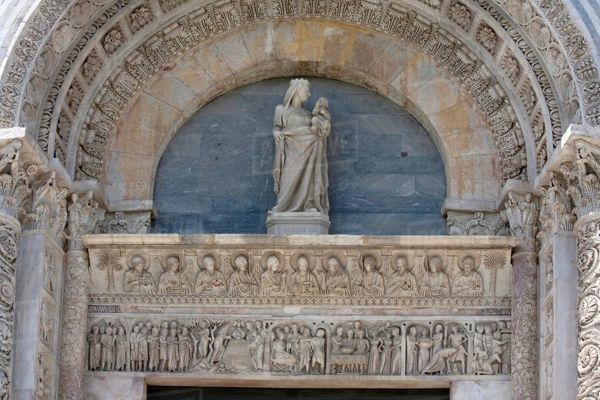 Statue and relief carvings in archway stock photo dissolve