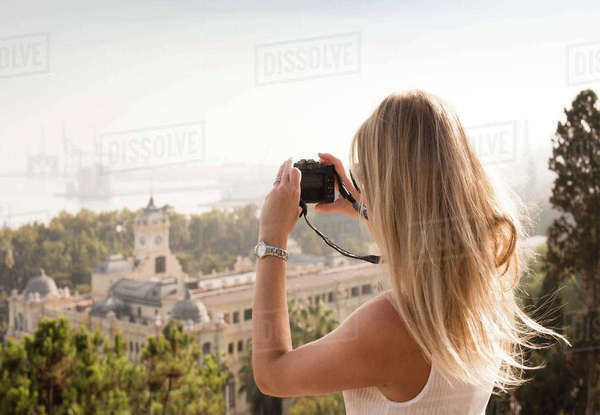 Woman with camera sightseeing, Malaga, Spain Royalty-free stock photo