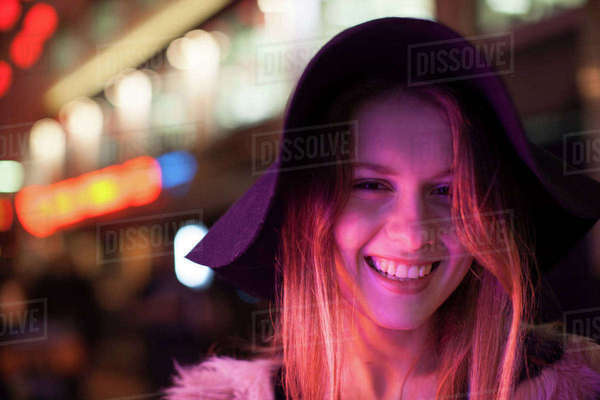 Young woman enjoying bright neon lights of street, London, UK Royalty-free stock photo