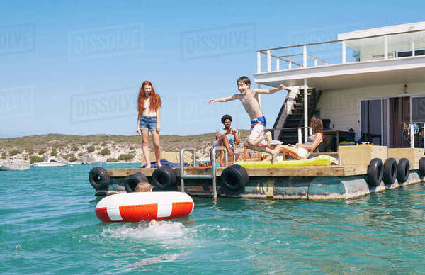 Family having fun on houseboat sun deck, Kraalbaai, South Africa Royalty-free stock photo