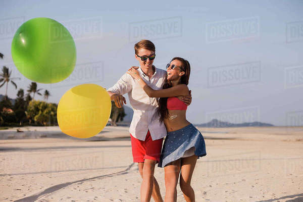 Young couple on beach playing with balloons, Koh Samui, Thailand Royalty-free stock photo