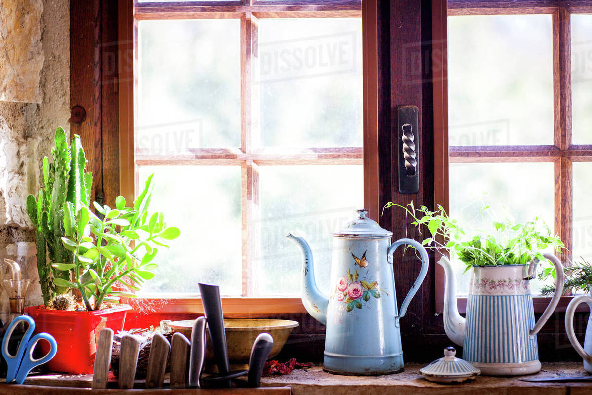Rustic Coffee Pots And Pot Plants On Kitchen Windowsill