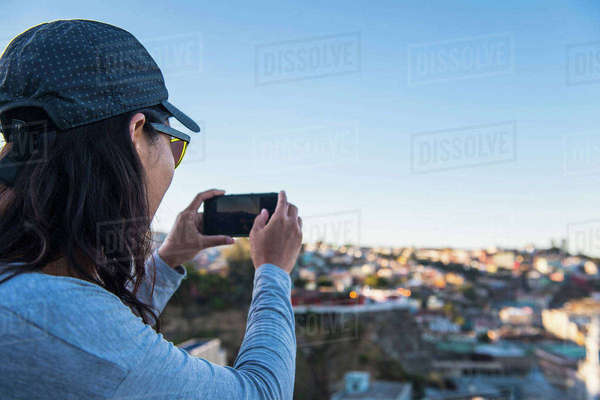 Woman taking photograph with smartphone, Valparaiso, Chile Royalty-free stock photo