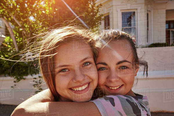 Teenage girls having fun in residential street, Cape Town, South Africa Royalty-free stock photo