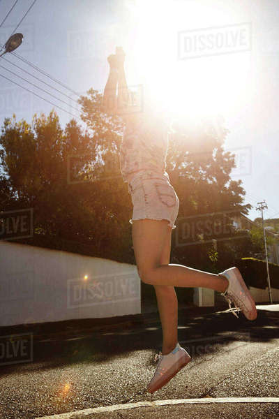 Teenage girl jumping in street, Cape Town, South Africa Royalty-free stock photo