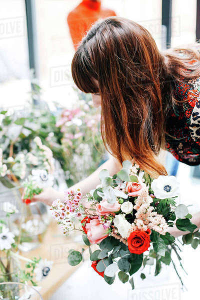 Florist student selecting cut flowers at flower arranging workshop Royalty-free stock photo