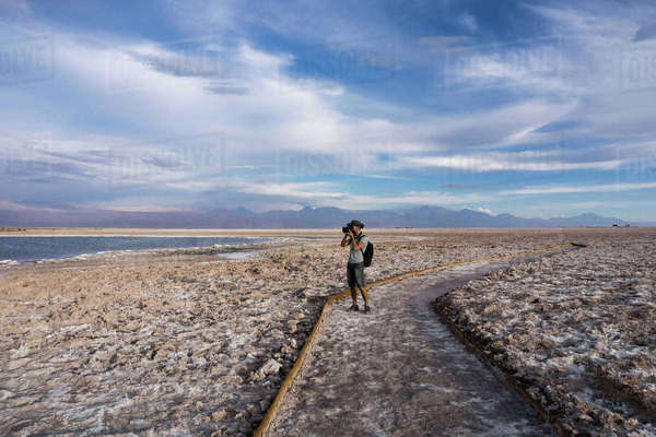 Photographer on snow covered landscape, San Pedro de Atacama, Chile Royalty-free stock photo
