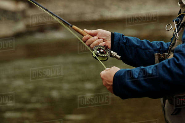 Man fishing in river, close-up Royalty-free stock photo