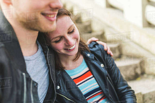 Romantic young couple sitting on stairway in Battersea Park Royalty-free stock photo