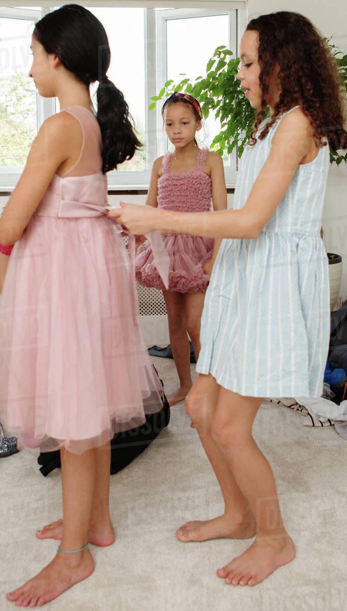 Girls Trying On Dresses