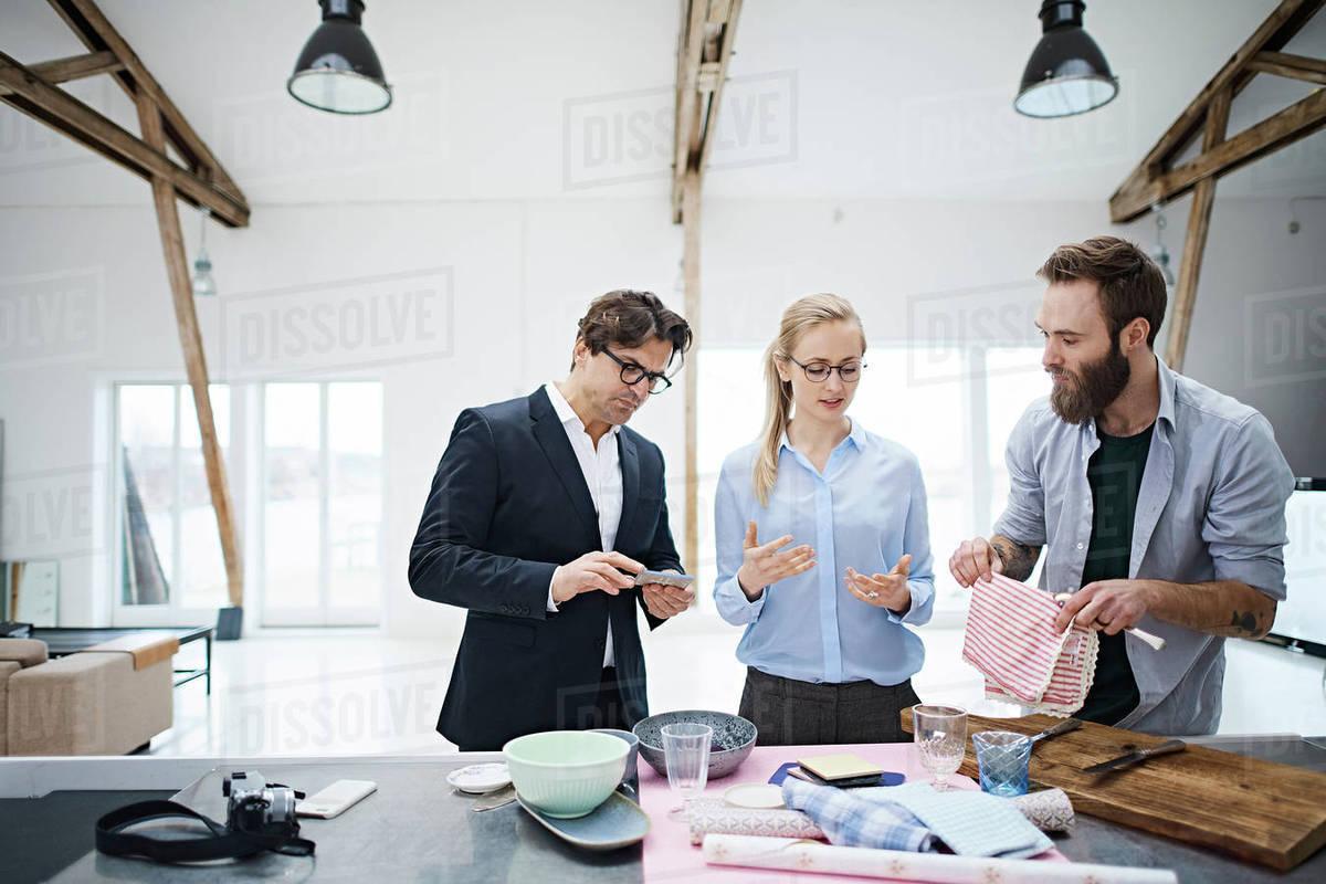 Interior Designer Team Looking At Kitchenware In Design Studio D943 222 552