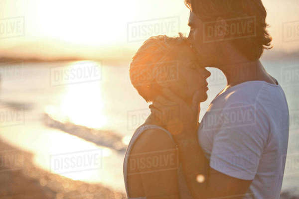 Couple kissing on beach Royalty-free stock photo