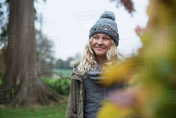 Girl in knit hat strolling in rural landscape Royalty-free stock photo