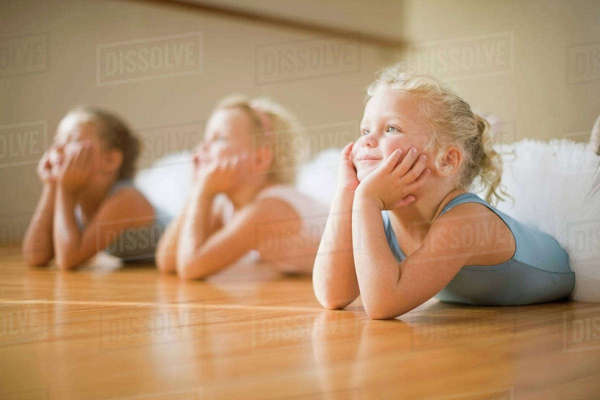 Girls laying on floor in ballet class Royalty-free stock photo