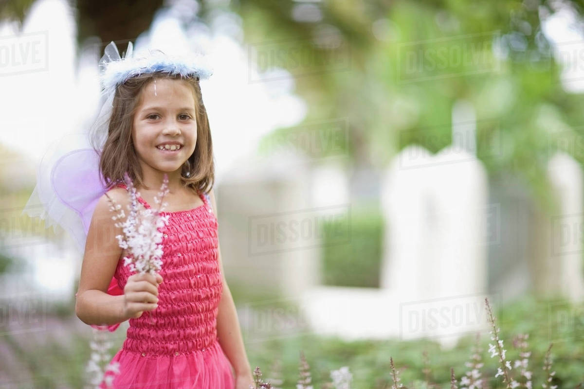 Girl in fairy costume holding flowers Royalty-free stock photo