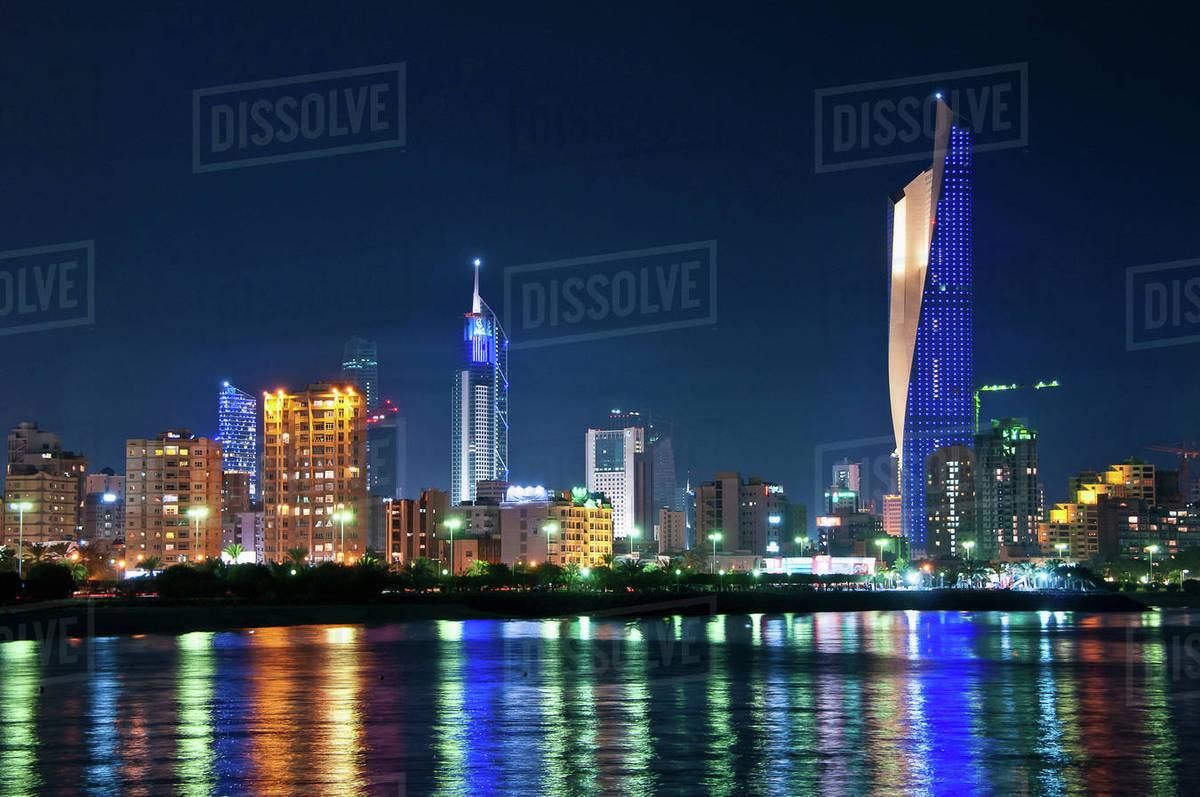 Kuwait City skyline reflected in water stock photo
