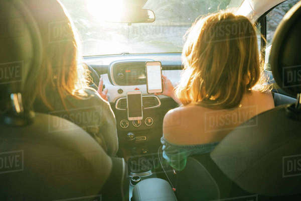 Rear view of friends in car using smartphone, Firenze, Toscana, Italy, Europe Royalty-free stock photo