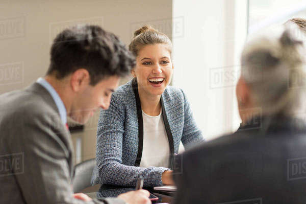 Businessman meeting female colleagues in boardroom Royalty-free stock photo
