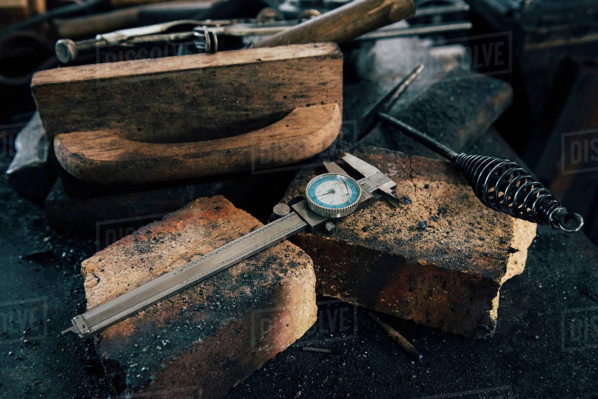 Blacksmith tools on workshop bench stock photo