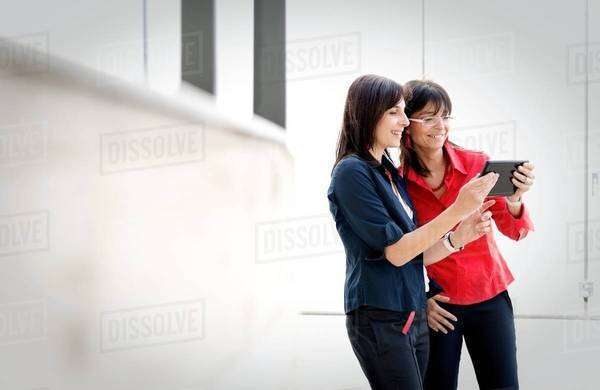 Businesswomen using digital tablet Royalty-free stock photo