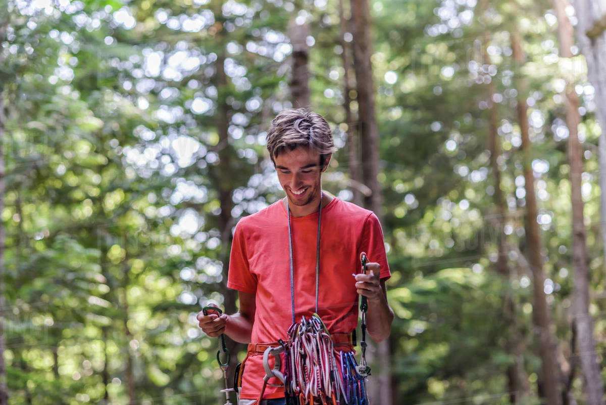 Happy rock climber in forest Royalty-free stock photo