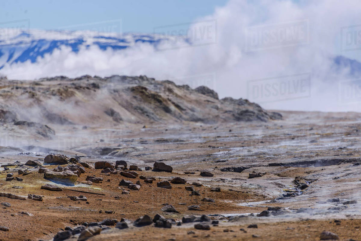 Barren landscape with steam rising beyond rocks, Akureyri, Eyjafjardarsysla, Iceland Royalty-free stock photo