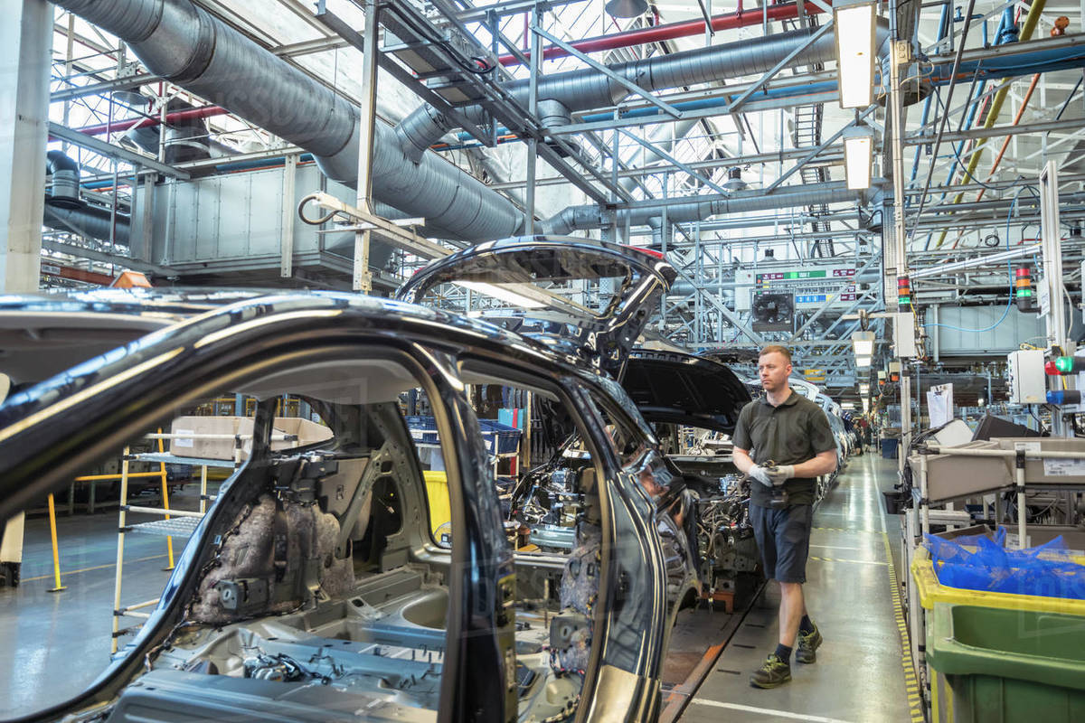 Worker on car production line in car factory Royalty-free stock photo