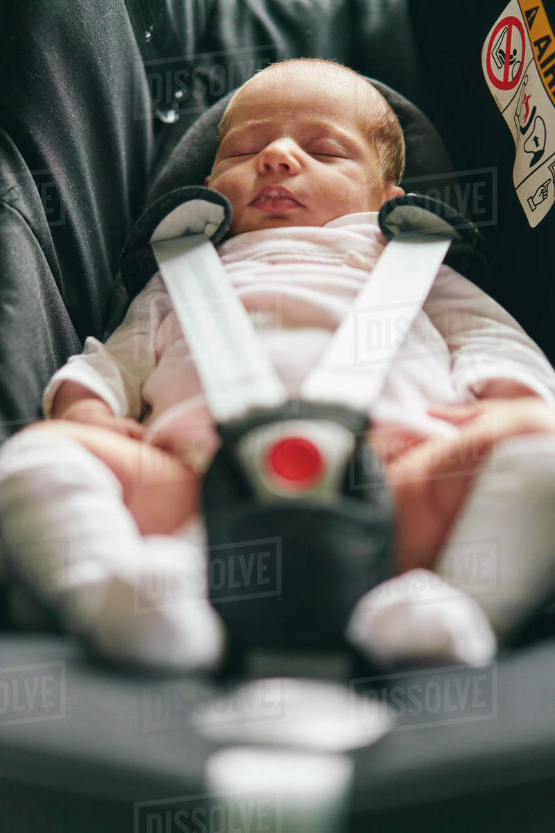 Baby buckled up in baby car seat Royalty-free stock photo