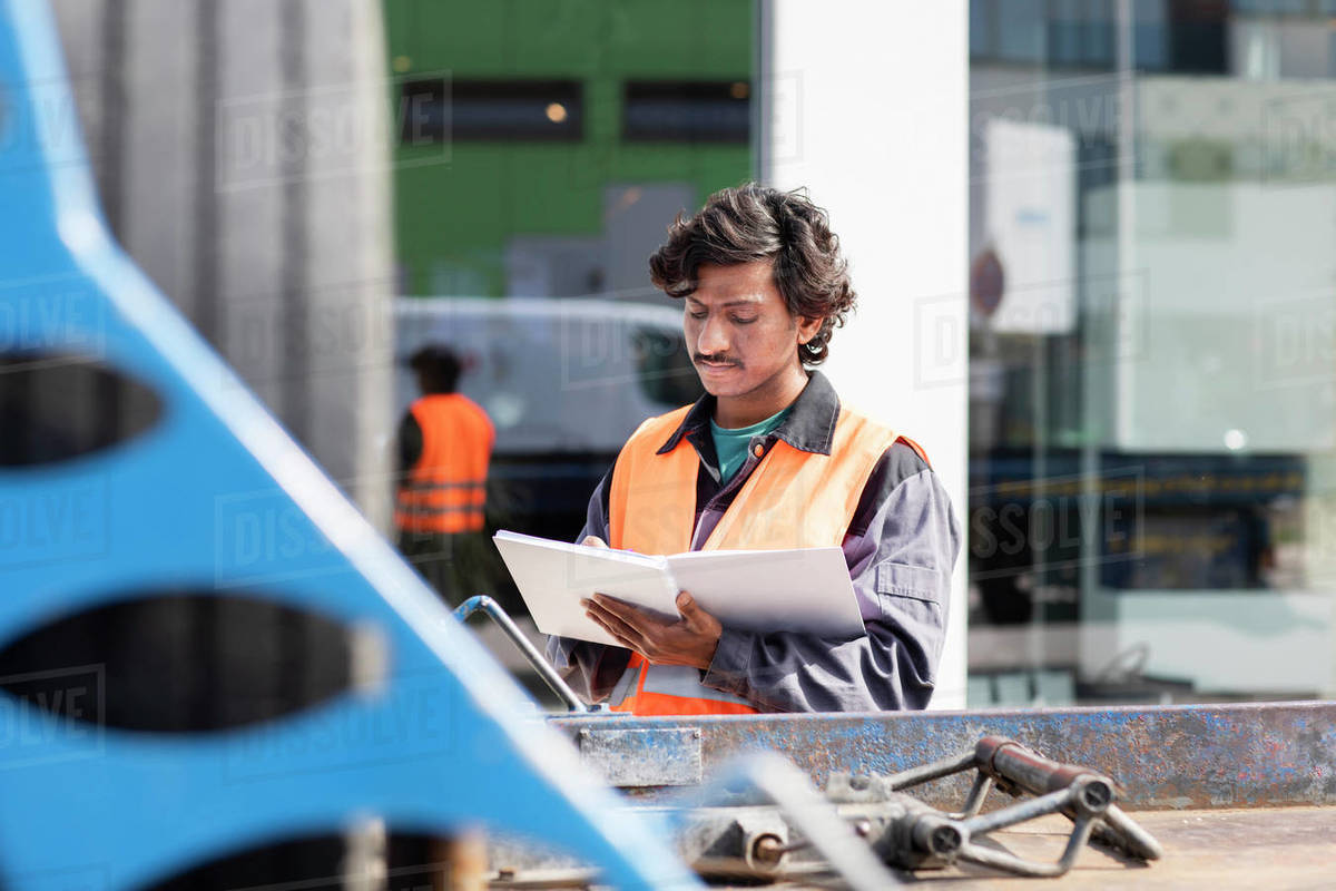 Male engineer on construction site writing in notebook Royalty-free stock photo