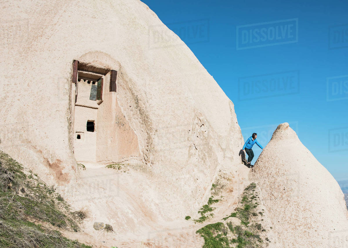 Woman exploring Uchisar Castle, Göreme, Cappadocia, Nevsehir, Turkey   Royalty-free stock photo