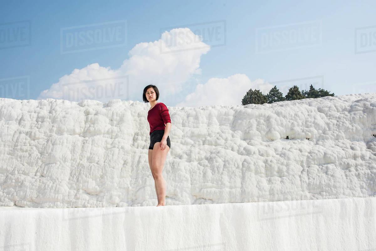 Woman enjoying cotton castle, Pamukkale, Denizli, Turkey Royalty-free stock photo