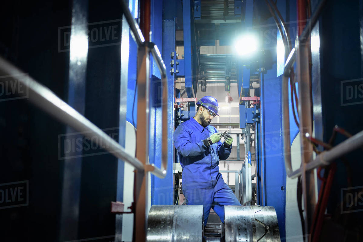 Engineer inspecting the turbine shaft in a nuclear power station. Royalty-free stock photo