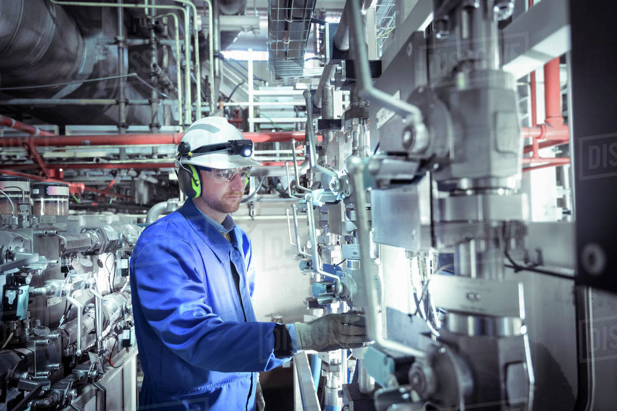 Engineer inspecting equipment in a nuclear power station. Royalty-free stock photo