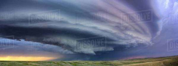 Large arcus cloud sweeps around the updraft of anticyclonic supercell with sunset colors projected on the cloud, Deer Trail, Colorado, USA Royalty-free stock photo