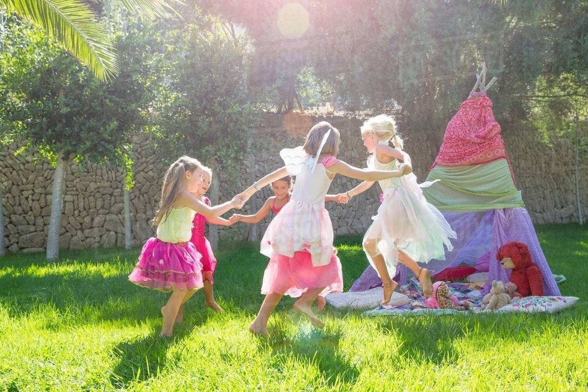 Five girls in fairy costume playing in garden Royalty-free stock photo