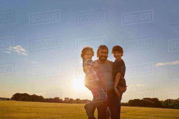 Father and sons out in the park Royalty-free stock photo