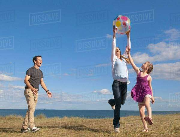 Family playing together outdoors Royalty-free stock photo