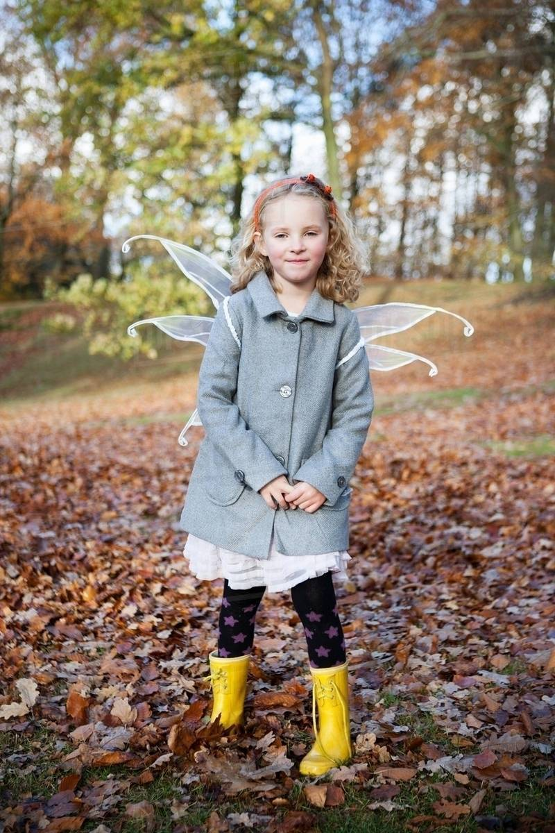 Girl wearing fairy wings in park Royalty-free stock photo