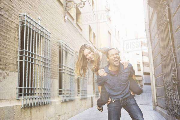 Tourist couple giving piggy back ride, Valencia, Spain Royalty-free stock photo