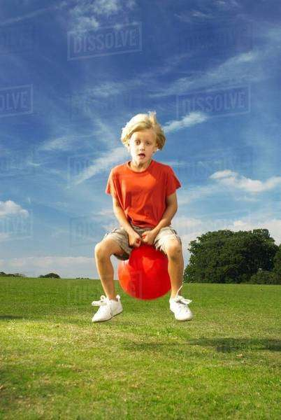Boy on space hopper Royalty-free stock photo